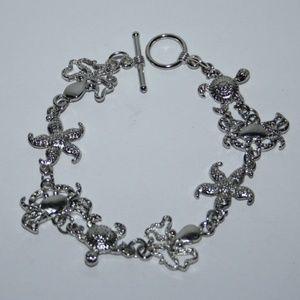Beautiful silver sea life charm bracelet toggle
